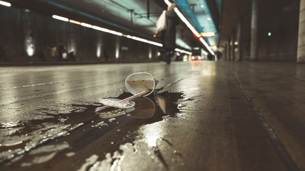 A paper cup spilled on the road.