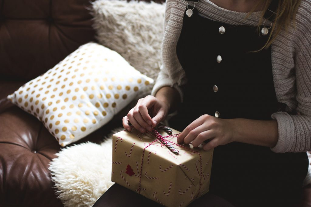 A woman opening a gift box.