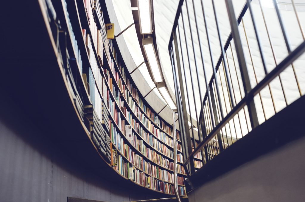A library wall full of books.