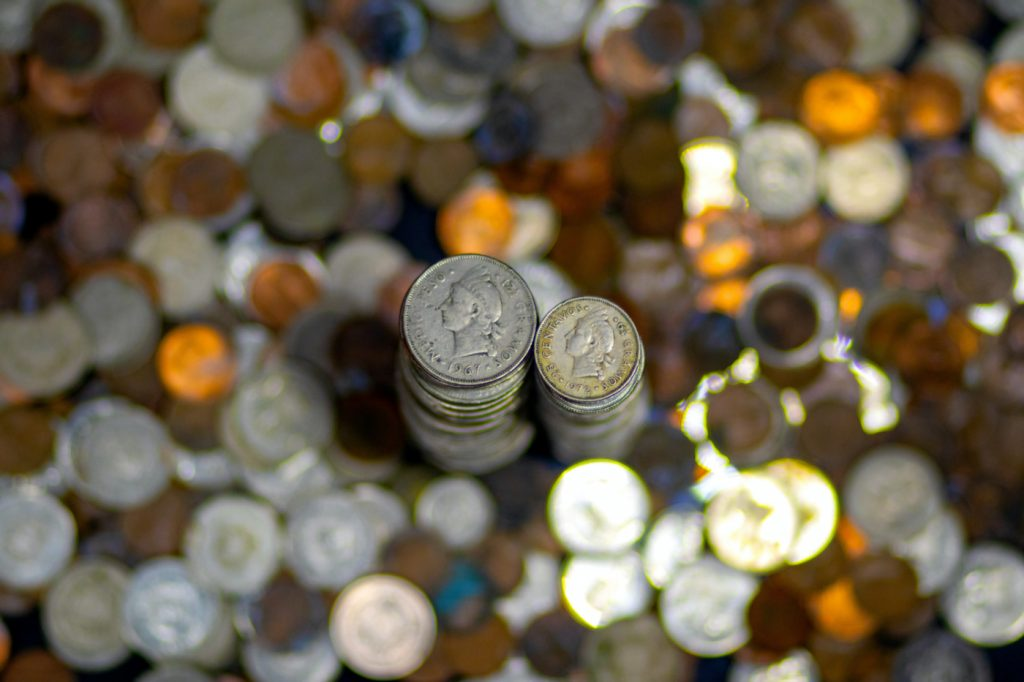 A stack of silver coins on a desk.