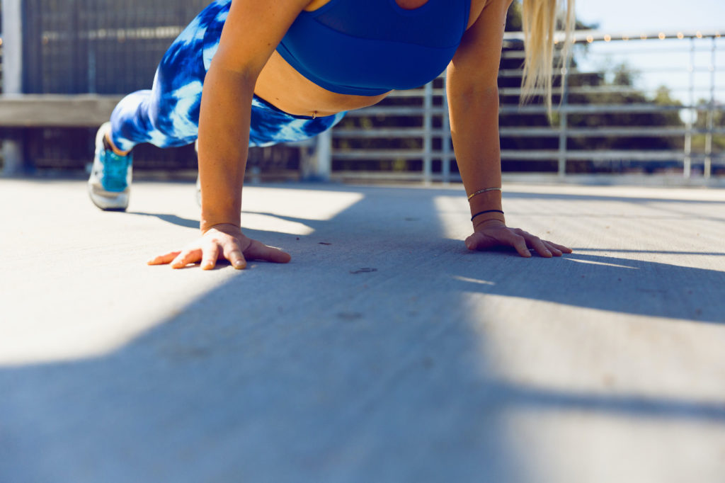 A person doing push-ups.