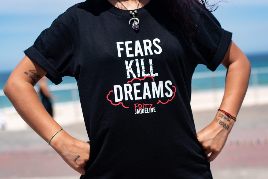 """A person wearing a shirt with the inscription """"fears kill dreams."""""""