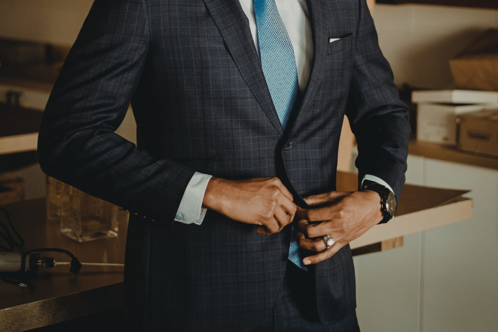A person wearing a suit and a tie.