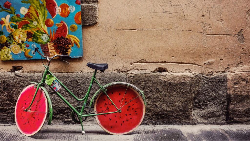 A bicycle with wheels that look like watermelons.