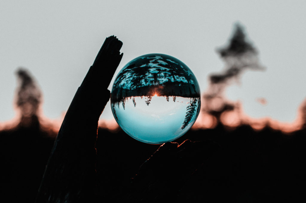 A lens ball that distorts the scenery in the background.