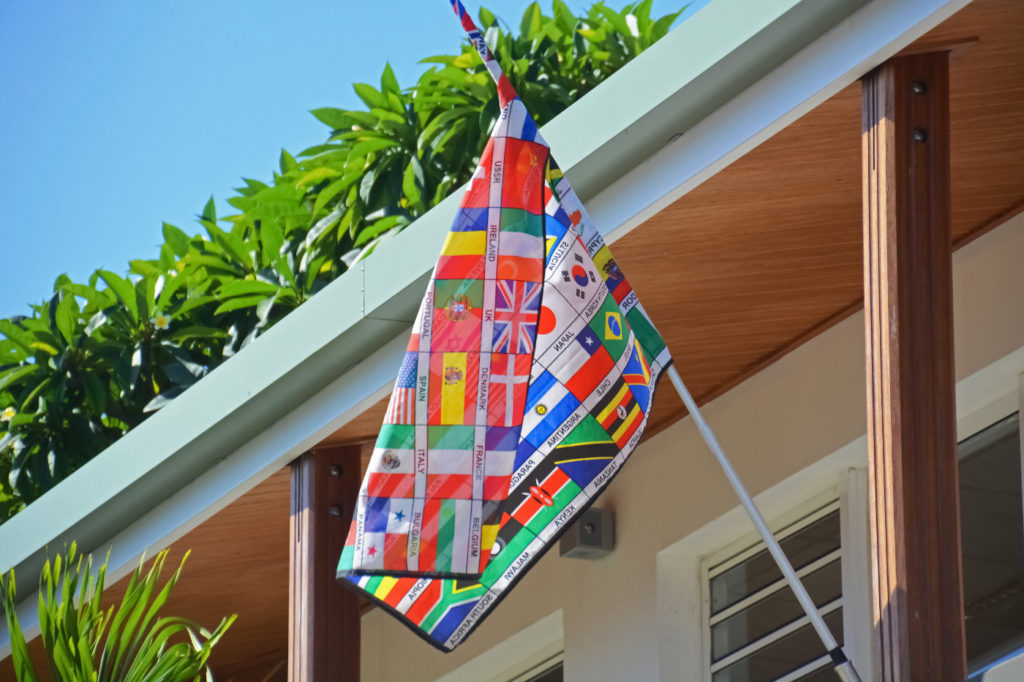 A banner that consists of flags of many different nations.