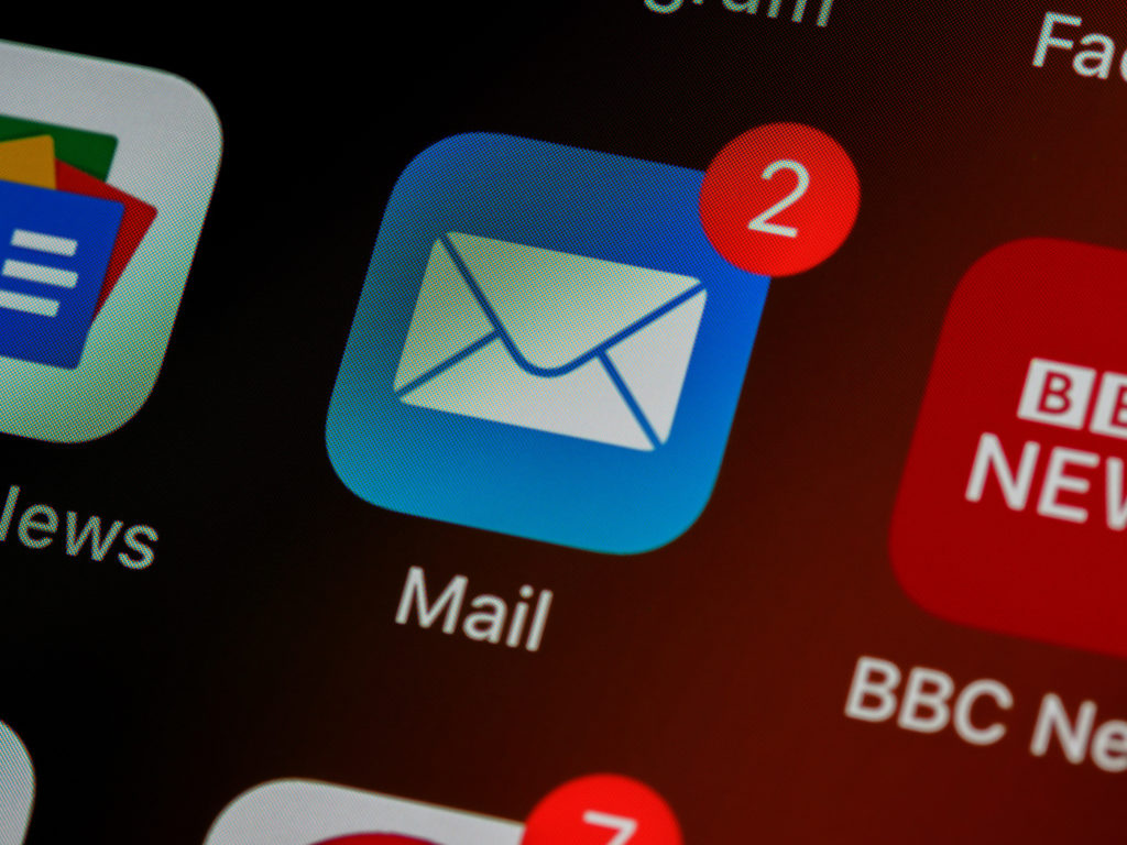 A mail icon on a device screen with a red number 2 indicating incoming messages.