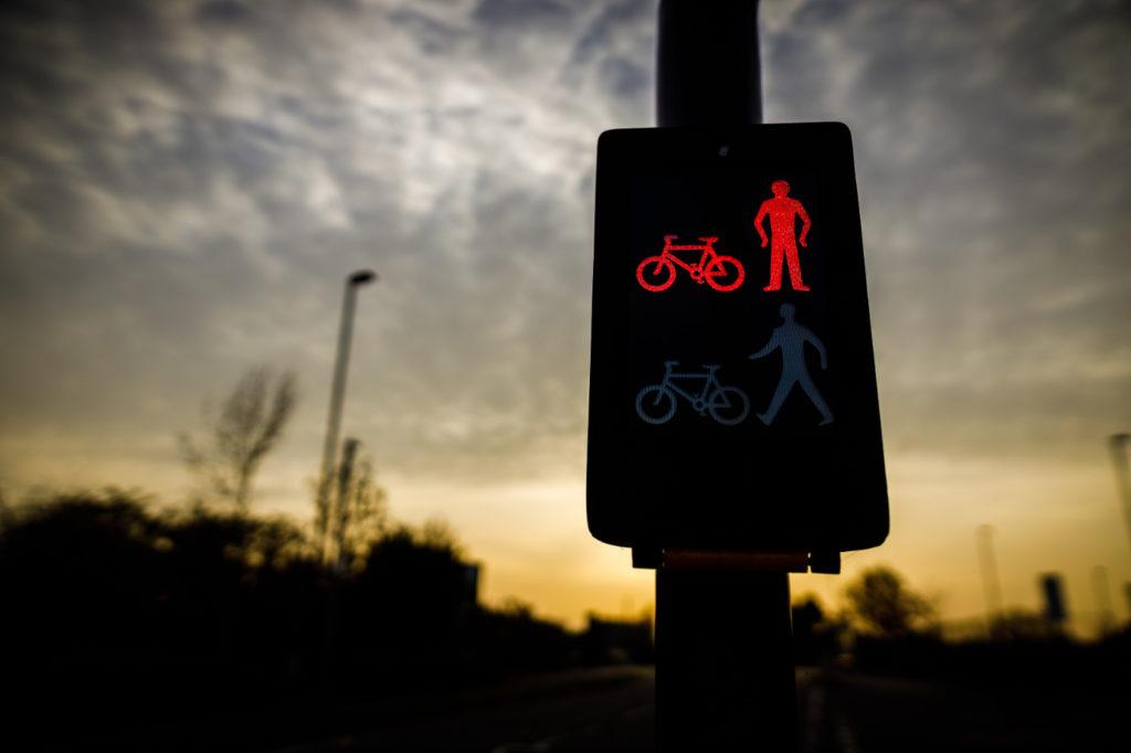 A red light on a pedestrian crossing traffic light.