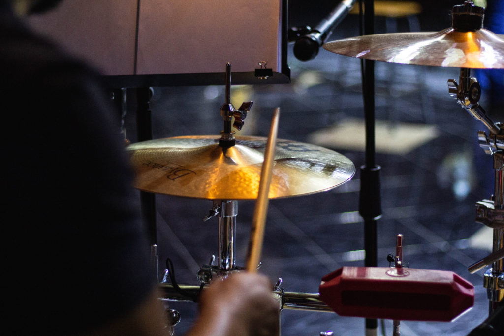 A person practicing drums.