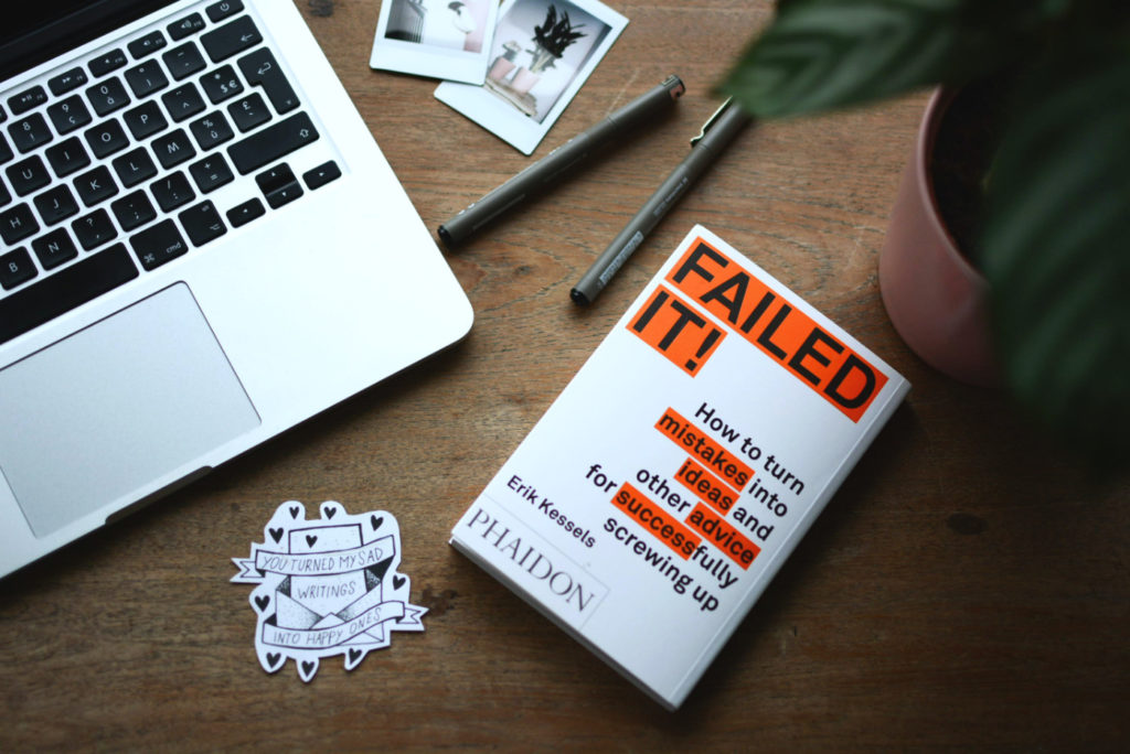 """A book """"Failed it! How to turn mistakes into ideas and other advice for successfully screwing up"""" on a desk."""