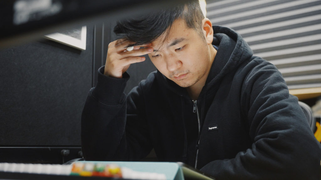 A person working at a desk with a concerned look on their face.